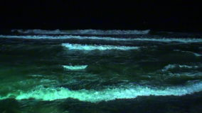 Seascape and waves glow at night in Maldives. stock video