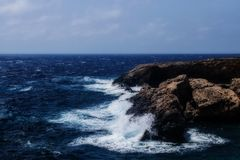 Seascape and waves hitting Rocks. In Lapsi area in Malta Stock Image