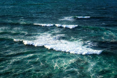 Seascape with waves on rough sea Stock Photos