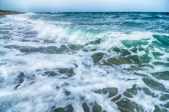 Seascape with waves and sand beach Stock Photos
