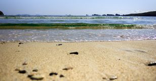 Seascape with waves, sandy beach and rocks on the horizon. stock photography