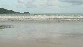 Seascape with waves on sandy shore. cloudy sky and tropical beach.  stock video