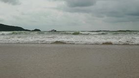 Seascape with waves on sandy shore. cloudy sky and tropical beach.  stock footage
