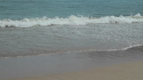 Seascape with waves on sandy shore. cloudy sky and tropical beach.  stock video footage