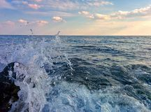 Seascape with waves and splashes. Seascape with waves, splashes and clouds Royalty Free Stock Photos