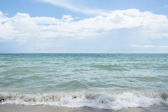 Seascape and white clouds with blue sky Stock Photos