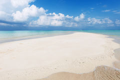 Seascape with white sand on the beach and blue sky with clouds Stock Photography