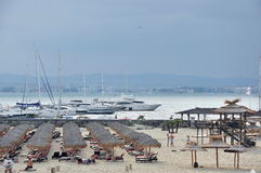 Seascape, yachts, people on the beach Stock Images