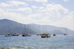 Seascape with yachts and ships by the port. Seascape with yachts and ships swimming by the port royalty free stock photography