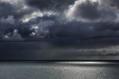 Seascapes with amazing clouds. Sun and sea royalty free stock photos