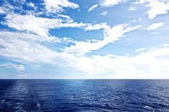 Seascapes. Various kinds of colorful blue sky, sun, clouds and open spaces of the world ocean. View from the side of a sea ship while moving and in the port at stock image
