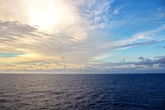 Seascapes. Various kinds of colorful blue sky, sun, clouds and open spaces of the world ocean. View from the side of a sea ship while moving and in the port at royalty free stock photos