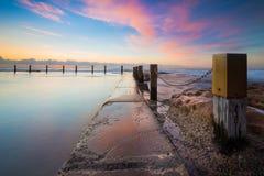 Seascapesikt på soluppgång Arkivfoto