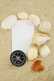 Seashell with compass and blank card Stock Photo
