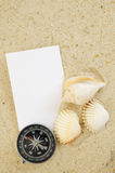 Seashell with compass and blank card Stock Images