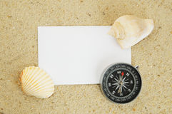 Seashell with compass and blank card Royalty Free Stock Images