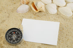 Seashell with compass and blank card Stock Photos