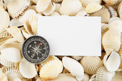 Seashell with compass and card Royalty Free Stock Photo