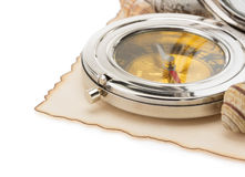 Seashell and compass on old paper. At white background Stock Photo