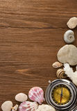 Seashell and compass on wood Royalty Free Stock Photo