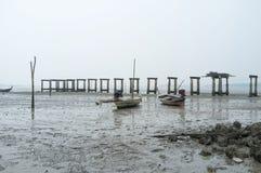 Seashell and fishing boat on beach. Seashell rock and fishing boat on the beach Royalty Free Stock Photo