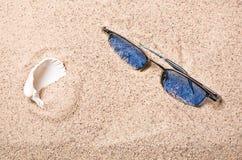 Seashell and glasses Stock Photos