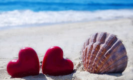 Seashell with hearts  by the ocean Stock Image