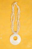 Seashell Necklace on Gold Background #2 Stock Photo