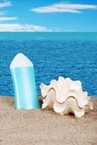 Seashell and suntan lotion Royalty Free Stock Images