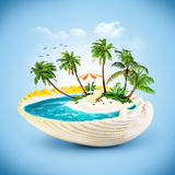 Seashell. Tropical island in the seashell. Travelling, vacation Royalty Free Stock Photos