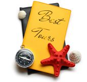 Seashells on best tour brochure Stock Photo