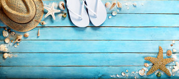 Seashells on blue wooden Royalty Free Stock Photos