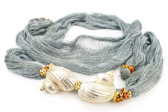 Seashells on colourful female scarf Royalty Free Stock Image