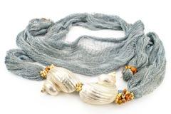 Seashells on colourful female scarf Royalty Free Stock Image