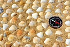 Seashells and Compass Stock Photo