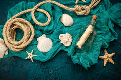 Seashells on dark turquoise background Royalty Free Stock Photos