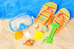 Seashells and diving mask on the beach Royalty Free Stock Images