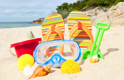 Seashells and diving mask on the beach Stock Photos