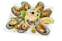 Seashells in einer Platte Lizenzfreie Stockfotografie