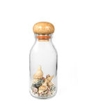 Seashells in glass bottle Royalty Free Stock Photography