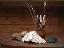 Seashells And Painting Brushes Royalty Free Stock Photography