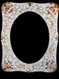 Seashells Photo Frame. Photo frame with seashells isolated over black Royalty Free Stock Photo
