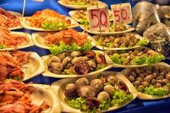 Seashells on a plate, Thai food. On the market Royalty Free Stock Photo