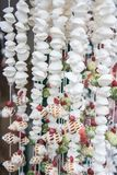 Seashells on rope thread for background. Colorful sea shells of various sizes of curtain for background, select focus with shallow depth of field Royalty Free Stock Photo