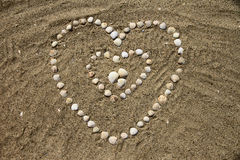 Seashells on the sand. In the form of heart Stock Photography