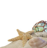 Seashells on sand with glass ball on white Stock Photos