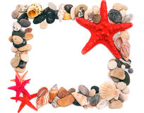 Seashells on sand picture frame Stock Photo