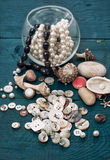 Seashells and sewing accessories Stock Images