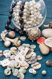 Seashells and sewing accessories Royalty Free Stock Images