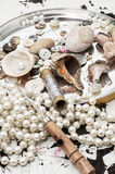 Seashells and sewing accessories Royalty Free Stock Photos
